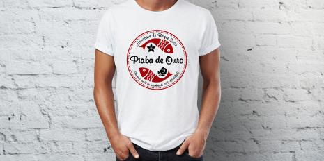 Cliente: Maracatu Piaba de Ouro. Peça: Aplicação do Logo em Camiseta. Feed Comunicação